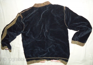 Handmade black velvet metalic jacket.