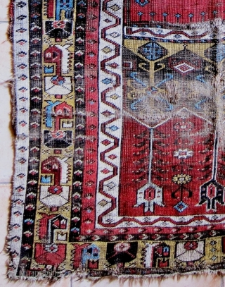 A 19th Century Ladik Prayer Rug   Size 184 x 114 cm A fragmented Ladik prayer rug in poor original condition, losses to selvedges and both ends, with good colours, very soft handle,  ...