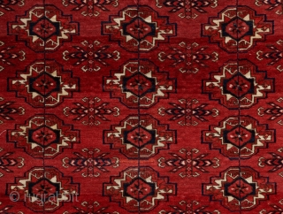 Super quality Tekke wedding rug in great condition. Fine weave and brilliant color. A very well articulated field, border and elem panel design. Near perfect condition with velvety medium pile all around.  ...