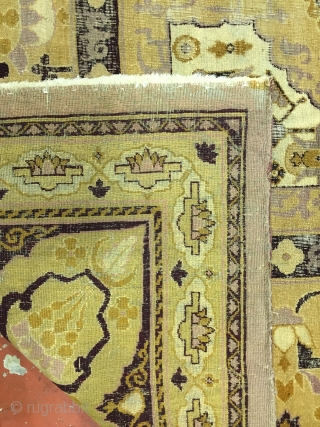 Rare antique Agra rug. Distressed condition. Background is a beautiful dusty rose. Detail colors include gold, deep maroon, butter yellow, and cream.