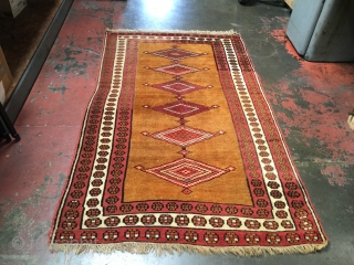 Gold ground Kurdish rug with great graphics. Size is 4'1 x 6'7. Glossy wool, plush pile, natural dyes except one pink accenting three medallions. The pink actually looks great on this rug.  ...