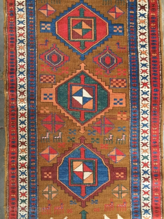Outstanding antique Persian tribal runner rug woven by Kurdish weavers in western Persia. This one of a kind runner features rich earthy natural dyes depicting birds, antelope, elemental amulets, and six unique  ...