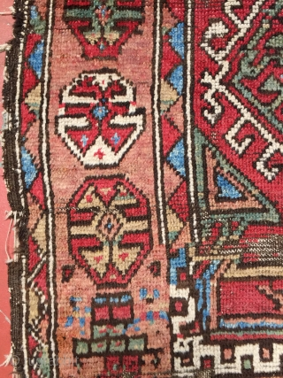 "Anatolian Kurd rug fragment. Size is 4'8"" x 5'4"". All natural dyes. Homemade stabilization of holes, tattered edges, and wear. Questions welcome."