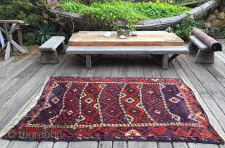 "Wild and woolly south east Anatolian Kurdish rug from around 1890. Gaziantep or Malatya origin. Bright all natural dyes. Long (1.5cm+) ultra soft wool pile. Finely knotted. Large size: 4'10"" x 7'3"".  ..."