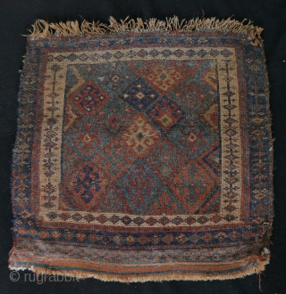 playful antique jaff bagface, natural glowing colours, 