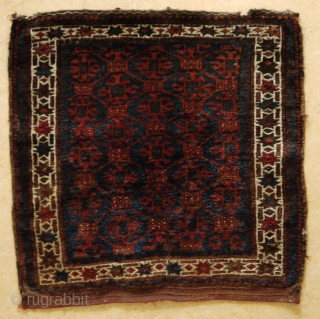 Baluch bag face with lattice design, full pile, some slight traces of use at the border, natural colours except for a few green knots. 