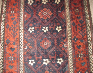 Minakhani Baluch Rug, Depressed warp Khorossan type. Very finely drawn with vivid color and finer than most of this genre. The skirts of this piece are executed in pile rather than kilim.  ...