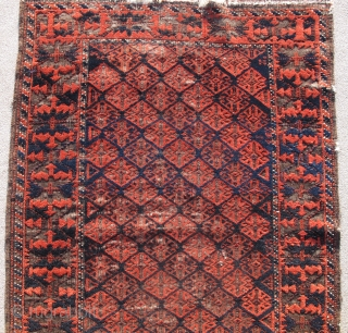 Fine Antique Baluch Rug, Great scale and drawing with several dark blues and practically sculptural corrosion to the browns. Khorosan variety an all-over repeat field derived from flatweaves and a boldly drawn  ...