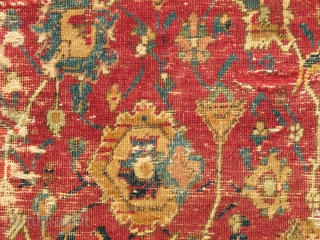 Central Persian Isfahan Carpet, Safavid era, first half 17th century, silk and cotton warp, cotton weft, lac red ground, fine weave, cut and shut, scattered old repair and damage, still majestic. size=  ...