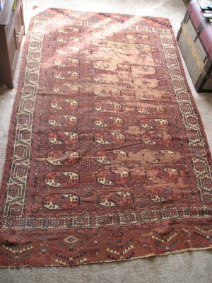Yomut Tauk Nuska Gol Main carpet. Old but damaged. Very nicely drawn minors.