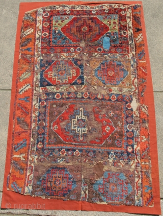 East Anatolian Kurdish Rug with  Memling Guls. Probably 18th century with a rich, diverse and moody color palette, exceptional wool and dramatic drawing. Worn and fragmented but gorgeous, mounted and conserved.  ...