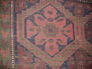 Antique Baluch Rug with rosettes in a lattice. All narural colors. 89x 152 cm(35''x60'' inches)