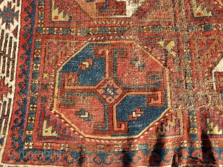 Very Old Central Asian / Uzbek main carpet with crosses in octagons. Great diverse color and an amazing border of a type I have never seen anywhere else. The negative space forms  ...