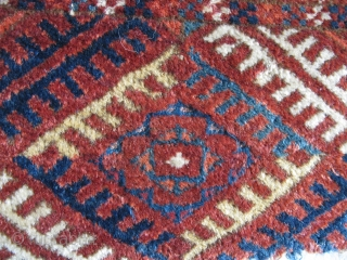 Tekke Long Rug, All colors are good, wool is soft and there are some silk highlights. Complete but with areas of wear and a stain at the very top. Older than most  ...