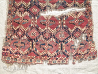 Ersari or Uzbek rug with an ikat (ak kymak) design. Fragmented, mounted, and conserved.