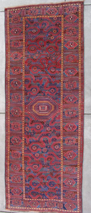 Cloudband Bashir Carpet, fantastic color with several blues and green. Condition is good with a little scattered repair and repair the sides. The length is 11 feet long.