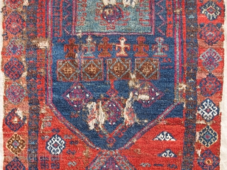With the format of a yastik and the general size and orientation of a prayer rug, this East Anatolian Kurd weaving seems to be something else. There are ewers drawn towards the  ...