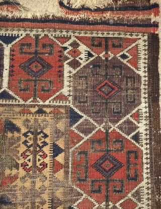 "camel ground Baluch rug. Intriguing design with a border inspired by Shahsevan sumaks. Finely woven but with corrosive browns and obvious wear. Flat back and 4 chord goat selvedge. 2'9""x4'2""