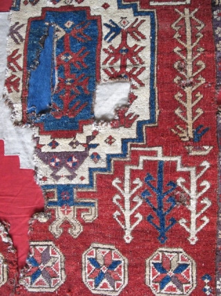 Ladik Medallion Rug, fragmented and mounted, deep color saturation.