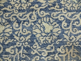 17th / 18th century Chinese (Gansu or East Turkestan) pile carpet fragment with a classic Ming lotus and peonies vine-scroll design made into a saddle blanket probably in the 19th. size= 19'×53'.  ...