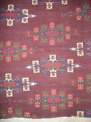 "Fragment of an old and great Yomud kepse gul carpet with rich color including super saturated green and blue-green.  Great handle, symmetrically knotted with some staggering/ alternation of knotting. (apx. 33""  ..."