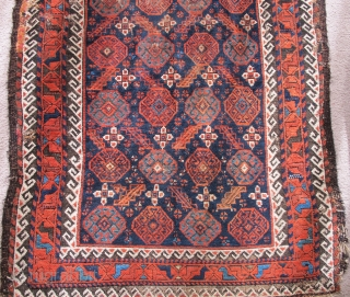 Arab? Baluch Rug . asymmetrical knot open right but with 4-chord goat selvedge. Running dog minor borders and other features of Khorossan minakhani Baluchis of the depressed warp type but without the  ...