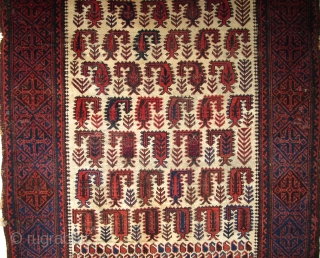 Baluch white-ground rug with scorpion-like botehs and smaller botehs
