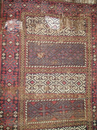 Enigmatic Baluch weaving. Probably a Poshti but perhaps some other sort of bag or bridge. It is symmetrically knotted  using a design repertoire  more commonly seen in flat-woven pieces. The  ...