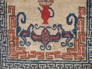 Unusual small Chinese rug with auspicious bats and flower pots. Uncommon use of madder red and un-dyed brown wool pile. cotton foundation. Perhaps Ningxia but seems a bit aberrant.  Perhaps Gansu  ...