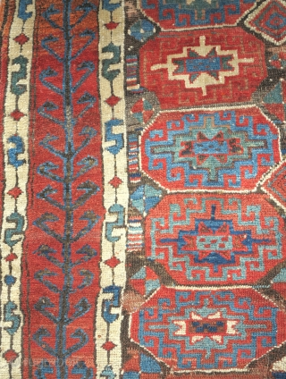 Kurdish rug from Northwest Persia with Memling guls and abstracted tree borders. Bold drawing with a corroded brown ground that gives a nice sculpted look.