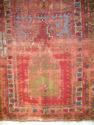 Smashed but Fantastic Anatolian Prayer Rug. Mudjur / Kirshehir type with super-saturated colors including vibrant red and blue, true aubergine, two greens orange and golden yellow. The border system represents familiar elements  ...