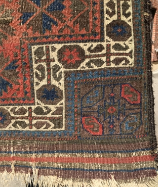 A highly unusual red ground Baluch prayer rug, Symmetrical knotted. 
