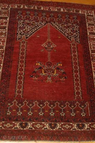 A Navajo rug. A Beshir prayer rug.