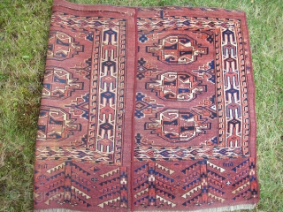 Yomud chuval - 2.7 x 3.10.  Attractive skirt and border elements. Ends original, sides not.  Soiled and slight staining.  Needs good cleaning.  Even wear, one small hole,