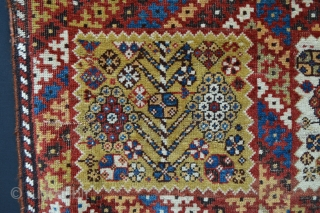 Rare, compartmentalised, small knotted-pile mid 19th century Qashqa'i rug in poor condition with various old reweaves but incredibly beautiful and collectable. Age is difficult to determine but this rug has a very  ...