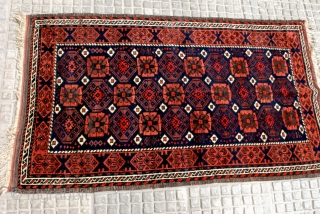 Very attractive Small Baluch rug with a clean Mina Khani design. Early 20th c. 85 x 143 cm. Shiny high pile and a beautifull blue-black indigo ground  . Secured end kilims.  ...
