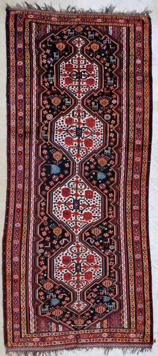 Luri rug, late 19th c. 145 x 338 cm. Brilliant saturated and contrasting colors and very pleasent design. Low pile to lower end but not dramatic. Nice checkered polychrome end kilims. Good  ...