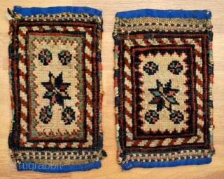 A pair of Quchan Kordi pan-holders, approx. 17 x 27 cm each, good condition, all good colours. Blue fabric added to ends. Goat smelling, would bear a good cleaning.