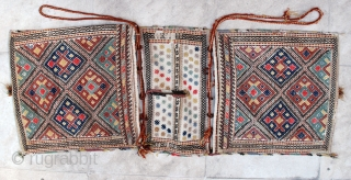 NW Persian complete saddlebag, early 20th c. 42 x 111 cm. Wool extra weft brocade on cotton. Nice natural colours, but some fuchsine and a few bright red highlights. Fine weave, Excellent  ...