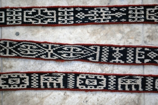 "Bakhtiari pack band with carved wodden lock and a rich variety of archaic and characteristic motifs. 5 x 830 cm. (2"" x 27'8""). Well preserved in general with very few slightly damaged  ..."