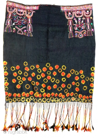 """Cotton embroidery on """"resist dying"""" felted wool textile. South Tunisian bride's headdress, first half 20th c. 83 x 91 cm (2'9"""" x 3')ex tassels. V good condition."""