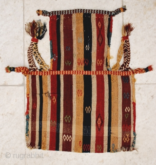 Antique jajim-woven Qashqai namakdan  (salt-bag), late 19th c. 44 x 58 cm. Some weft float brocadeed motifs on warp-faced ground. Excellent natural colors. Slight tear in the centerleft of one face  ...