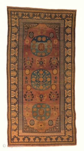 Khotan. Cm 205x390. Datable 1775/1825 (Structure docet!) Beautiful. Lovely central medallions. Great colors. In good condition. The only super Khotan available on the market. Serious inquires welcome.