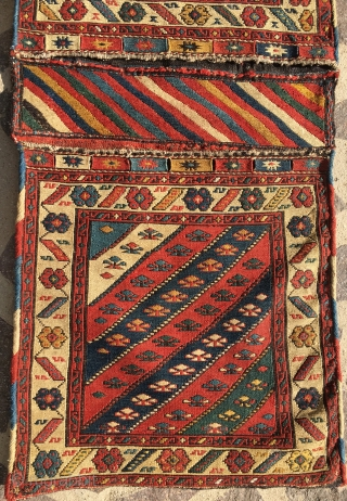 Sumack khorjin. Cm 48x114. End 19th c. Probably Shahsavan, or…. Shirwan, or..? Complete and in great condition. Lovely flower pattern. Fantastic natural dyes. A real beauty, a wonderful color explosion.