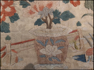 Two Ming Dynasty embroidery fragments, one on a yellow twill ground, and the other on a white damask ground. The yellow piece portrays birds in the branches of a plum tree surrounded  ...