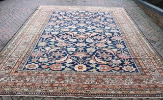 A good antique Ferahan carpet with unusual and massive Herat design on navy ground, a look reminiscent of early Kurdish carpets. Good condition, all over even low pile, minimal repair. Clean and  ...