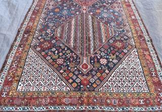 An antique Khamseh kelleh carpet, well made piece in excellent original condition in an unusual format. Circa 1900. 322cmx165cm 10ft7inx5ft5in