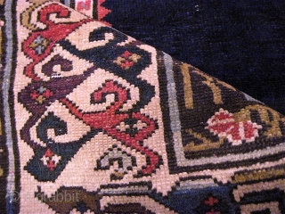 Unusual, elegant old rug....fine Karagashli weave, fantastic colors (a great aubergine; deep, dark green) and that plain, luminously deep blue field.  Was re-sized along the way, but still has presence and  ...