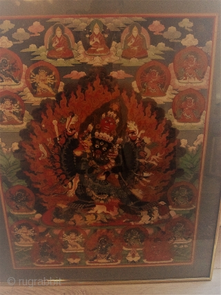 Sold!  Bizarre Tibetan Thangka full of finely detailed Bhudda and Archetype figures. Some are Grotesque and in decadent form while a Central figure displays a myriad of items attached to a blue tentacled disk. It  ...