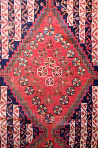 Khamseh-Qashqa'i Rug, 19th Century.  Kashmir shawl ground design with varying color schemes between the end sections and the center area with triple medallions. Selvedges mostly in tact with worn areas and  ...